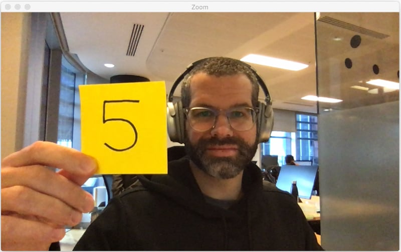 Holding up a sticky note while on a video call